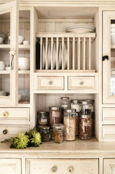 Farmhouse kitchen.... love all those nooks and crannies!  Just look at the plate rack and cubby for canisters and lots of drawers and...  Yes!