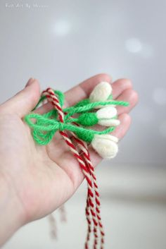 Set of three Martenitsa bracelet with small Needle Felt Snowdrop. Colors: Red and White, Green  *If you prefer it in a different color or merely wish to order more/less of them you may contact me.   History:  Martenitsa (Bulgarian: мартеница,) is a small piece of adornment, made of