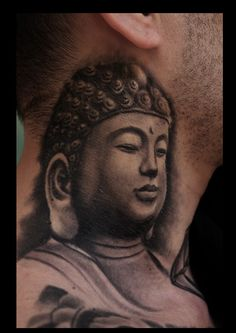 Buddha tattoo inked on clients neck by Cory Norris.