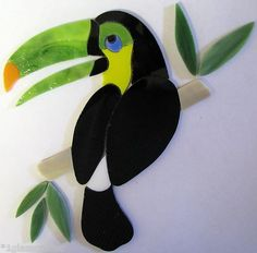 Adorable little Toucan precut stained glass inlay kit. Great for mosaic or suncatcher.