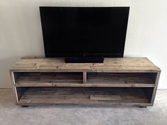 solid reclaimed wood media entertainment tv console unit stand center - custom rustic wood pallet reclaimed furniture beach house cabin by KaseCustom on Etsy https://www.etsy.com/listing/231210420/solid-reclaimed-wood-media-entertainment