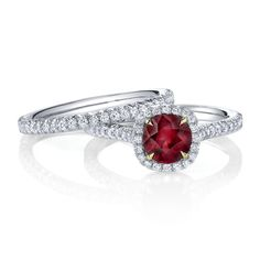 Omi Prive ruby wedding set - I'd want an emerald with silver claws not gold