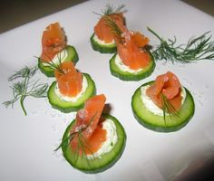 Smoked Salmon Canapes with Cucumber and Dilled Cream Cheese.... Not sure if anyone but me likes smoked salmon!