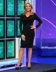 CACHE: Black sparkle jersey cocktail dress, front cowl neckline, long sleeve, skirt drapes to right-front waist | Wheel of Fortune | Vanna White's Dresses