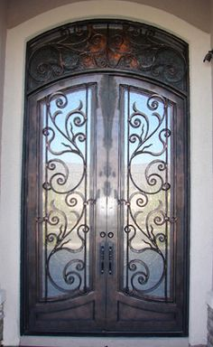 Custom wrought iron door with thin stile and hardware notch ...