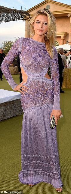 VIP: Leonardo's model girlfriend Kelly Rohrbach turned heads in her bold purple number, wi...