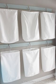 Laundry Organization at UsefulBeautifulHome.com**this is what I have been looking for! hampers for our small laundry room