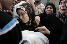 Nov. 15, 2012. The parents of 11-month-old Palestinian baby Ahmed Masharawi, killed in an Israeli strike, hold his body during his funeral in Gaza City
