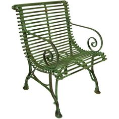 French Green Iron Garden Arm Chair with gracefully curved arms; originally designed for the Luxemborg Gardens; 20th Century.