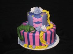Tangled (Rapunzel) themed cake.  Pascal and braid are created using fondant.  Flowers are hand crafted sugar flowers (gumpaste)