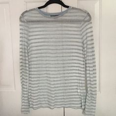 Vince blue and white striped t-shirt Shear blue and white striped long sleeve shirt. New without tags. Vince Tops Tees - Long Sleeve