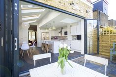 Tooting, SW17, Side return extension on a Victorian Terraced House in Tooting SW17, Greater London, Pitched Roof with Large Skylights, Open Plan Design, Contemporary White Kitchen, Kitchen Extension, Wood Floor, Bi-Fold Floors, Large Kitchen Island, Kitchen Extension Ideas, Kitchen Interior, Kitchen Design Ideas