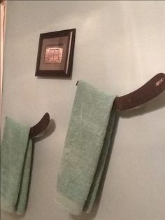 My sons bathroom hockey stick blade towel holders. :)