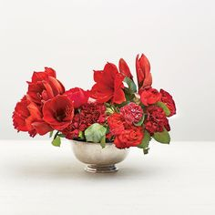 Red Punch Arrangement: Add some bolder flowers (such as anemones and ranunculus) above and in the center for depth. Allow their graceful stems to remain long, trimming them slightly only if necessary for balance.