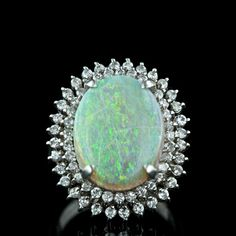1225829110_Opal_and_Diamond_Cocktail_Ring_Main_View30-1-457.jpg (500×500)