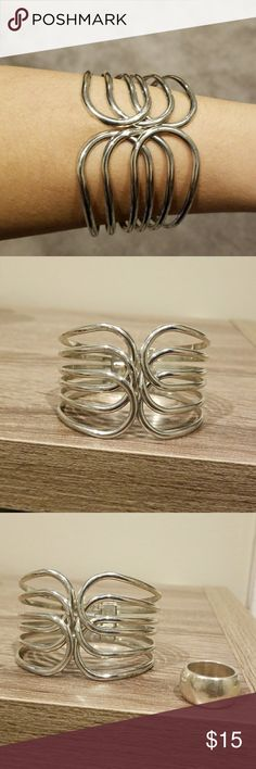 Silver cuff bracelet & ring Silver cuff bracelet with hinge open and close, & solid ring measuring probably a size 7 or 8. Ring shows signs of wear.  Both nice additions to any costume jewelry collection. Jewelry Bracelets #silvernicejewelry