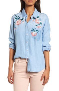 Vibrant floral embroidery enlivens this wardrobe-essential chambray shirt marked with a solo shadow pocket for a reworked vibe.