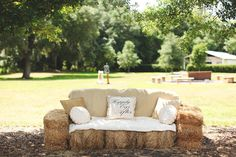 The coolest lounge idea for a rustic wedding - hay bales made into a couch! {Vine & Light Photography}