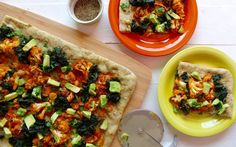 <p>That is what we call a pizza!  A dairy-free, creamy white garlic sauce on top of a thin herby crust, layered with spicy Buffalo roasted cauliflower, crispy kale, avocado, and fresh parsley. </p>