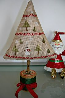 "A Sampler of Stitches - ""Oh Tannenbaum"" by Country Stitches, finished with a spool base (so cute! Xmas Cross Stitch, Modern Cross Stitch, Cross Stitch Designs, Cross Stitching, Cross Stitch Embroidery, Cross Stitch Patterns, Loom Patterns, Christmas Minis, Christmas Cross"