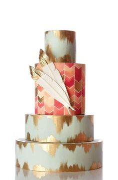 elegant boho cake with gold tipped feathers and chevron layer in center