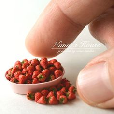 Miniature bowl of strawberries.