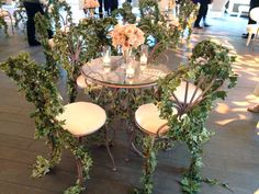 Greenery twisted around wrought iron chairs brought a hint of secret garden fantasy to this @Mandy Dewey Seasons Hotel Los Angeles at Beverly Hills wedding. @Four Seasons Bridal