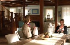 Emily and Nolan in her beach house-dining table