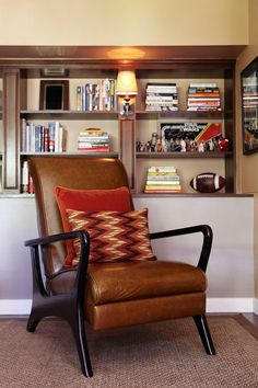 cozy space with rich woods and vintage furnishings. Retro throw pillows in solid and geometric prints add color and pattern to the mortise and tenon armchair.