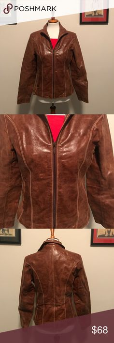Awesome 100% genuine brown leather jacket Great for layering with sweaters and tees for the fall! 100% Wilson Genuine Leather jacket. The outside is in perfect condition with leather imperfections (shown in pictures). The inside nylon is torn, so price reflects. Wilsons Leather Jackets & Coats