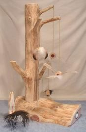 Red cedar, supposedly a great wood for scratching. Also a fab design with real branches! ~ET
