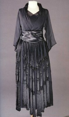 "Black silk satin and crepe chiffon evening dress with fringe overskirt, by Nadezhda ""Hope"" Lamanova, Russian, c. 1920."