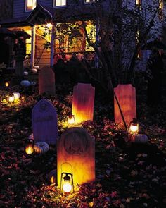 """Tombstone Yard Halloween Decoration -  Mound earth to look like newly dug graves and set out a few of these tombstones for a deathly welcome. The tombstones were carefully constructed out of polystyrene insulation. To ensure an easy cleanup, pile the dirt from the """"fresh graves"""" onto a black plastic drop cloth."""