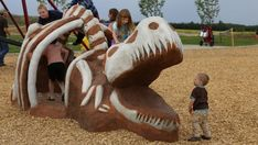 Leduc has opened Meadowview Dinosaur Playground to mark the discovery of a rare intact hadrosaur skeleton found there last year. Dinosaur Theme Park, Church Design, Playground, Skeleton, Discovery, Nova, Lion Sculpture, Museum, Canada