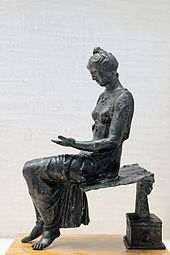 Bronze statuette (1st century AD) of a young woman reading