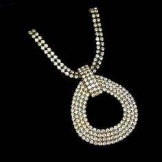 Vintage Large Oval Prong Set Rhinetones Pendant Statement Necklace Classic, $99 from www.myclassicjewelryshop.com. Rhinestones are perfect for the Christmas and New Year - they bring sparkle to any outfit. :)