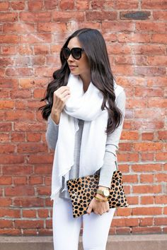 love the white and gray...perfect for a cool spring/summer evening.  Grey jumper.  Leopard clutch.  White jeans