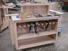 Shop cart idea. Rack to hold pneumatic nail guns a good idea to use on workbench or assembly table.