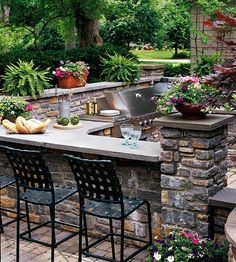 Outdoor Dining Area with Stacked Stone.  A built-in dining area to the left of the grill provides the perfect spot for a casual dinner or a place to entertain guests while you cook. The stacked-stone design of this outdoor kitchen blends well with the natural setting.