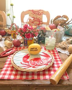 The theme of this tablescape is Crab boil or Clambake. It's a fun take on a seafood party. I had a bunch of lemons, potatoes, and corn so I pulled this together. I used newspaper and checkered napkins and as many crabs I had on hand.