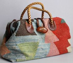 Lovely woven fabric contrasting with plaited leather handles, attachments and fastener