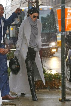 Work it:Kendall went for high style with a heavy and long light grey coat that matched her bulky turtleneck