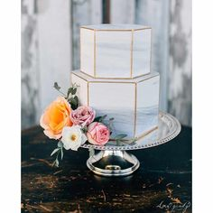 Add to your marble themed wedding with a deliciously delightful marble wedding cake like this one made by Baked Seattle. The gold and marble combo seems to be a running trend throughout this article and there's a reason for it – it's because it is such a strong colour combination and looks perfect no matter what it's used in.