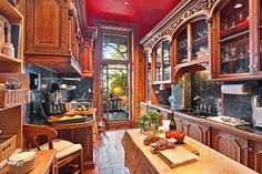 A kitchen opens onto a glass-enclosed solarium, at the rear of the duplex...A kitchen with lots of character..