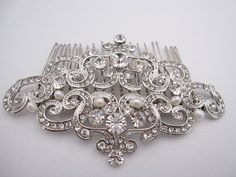 """This vintage inspired stunning fresh water pearl rhinestone hair comb is beautiful addition to your wedding day hair style on the side or in back with a veil, or in an updo. the rhinestone part measures approximately 4"""" X 2.5"""" ."""