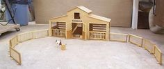 DIY horse barn and fencing plans.  Woulda loved to make this as a kid! Would still love to make this as an adult.