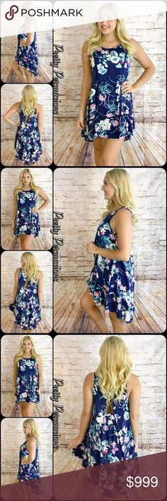 """NWT Navy Blue Floral Printed Shift Dress NWT Navy Blue Floral Printed Shift Dress   Available in S, M, L Measurements taken from a small  Length: 32"""" Bust: 38"""" Waist: 40""""  Rayon  * Also available in white combo *  Features  • floral printed design throughout • round neckline • sleeveless • crochet accents  • ruffle hem • small opening at back  Bundle discounts available  No pp or trades   Item # 1/105130380BFD floral print dress ruffle hem Pretty Persuasions Dresses"""
