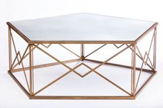 Pentagon shaped cocktail table with antique mirrored top.