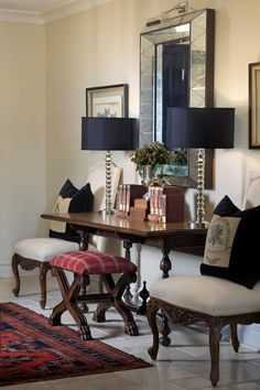 Spectacular Entryway with beautiful console table, bench, mirror, lamps and chairs.