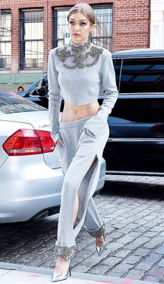 gigi hadid wearing all grey everything with a pair of silver pumps